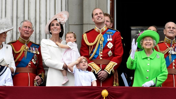 Members of the royal family, including Camilla Duchess of Cornwall, Prince Charles, Catherine, Duchess of Cambridge holding Princess Charlotte, Prince George, Prince William, Queen Elizabeth, and Prince Philip watch a flypast as they stand on the balcony of Buckingham Palace after the annual Trooping the Colour ceremony on Horseguards Parade in central London, on June 11, 2016.