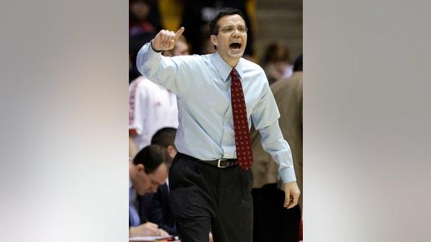 Nebraska head coach Tim Miles yells to his team during the first half of an NCAA college basketball game against Northwestern in Evanston, Ill., on Saturday, Feb.8, 2014. Nebraska won 53-49. (AP Photo/Nam Y. Huh)