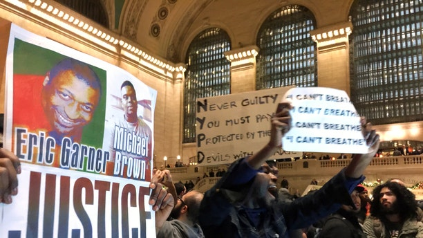 People protest in Grand Central Terminal on Wednesday, Dec. 3, 2014, in New York.