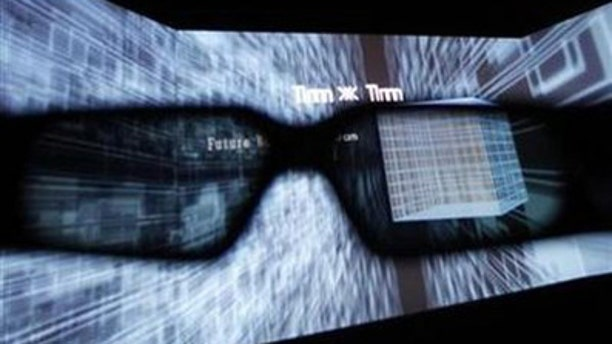 June 23, 2010: A 3D display is seen through glasses during a demonstration by virtual reality content and technology provider Solidray at the 3D and Virtual Reality Expo in Tokyo.