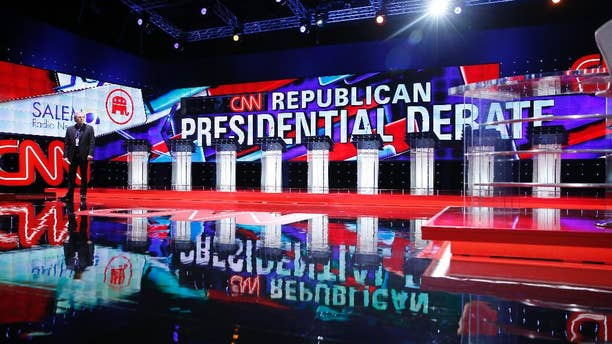 Podiums line the stage before the CNN Republican presidential debate at the Venetian Hotel & Casino on Tuesday, Dec. 15, 2015, in Las Vegas. (AP Photo/John Locher)