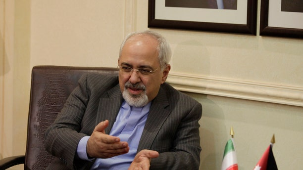 Iranian Foreign Minister Mohammad Javad Zarif meets with his Jordanian counterpart Nasser Judeh in Amman, Jordan, Tuesday, Jan. 14, 2014. Zarif visits Jordan as part of his regional tour of the Middle East countries including Iraq, Kuwait, Lebanon, Oman, Qatar and United Arab Emirates. (AP Photo/Mohammad Hannon, Pool)