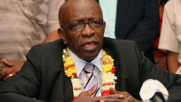 In this Thursday, June 2, 2011 file photo, suspended FIFA executive Jack Warner gestures during a news conference held shortly after his arrival at the airport in Port-of-Spain, in his native Trinidad and Tobago.