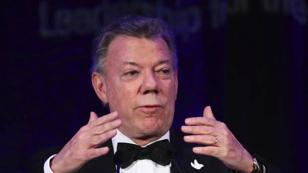 Colombian President Juan Manuel Santos, recipient of the 2016 Nobel Peace Prize, speaks after accepting the Inter-American Dialogue's Leadership for the Americas Award at the institution's annual gala dinner in Washington, Wednesday, Nov. 16, 2016. (AP Photo/Manuel Balce Ceneta)