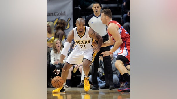 Indiana Pacers forward David West, left, backs down Los Angeles Clippers forward Blake Griffin (32) during the first half of an NBA basketball game in Indianapolis, Saturday, Jan. 18, 2014. Later in the first half, West was ejected on a flagrant foul on Griffin/ The Pacers won 106-92. (AP Photo/AJ Mast)