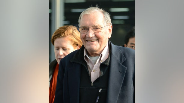 U.S. tourist Merrill Newman smiles upon arrival at Beijing airport Saturday, Dec. 7, 2013 after being released by North Korea. North Korea deported Newman who was detained for more than a month, apparently ending the saga of his return to the North six decades after he advised South Korean guerrillas still loathed by Pyongyang. North Korea made the decision because the 85-year-old Newman had apologized for his alleged crimes during the Korean War and because of his age and medical condition, according to the North's official Korean Central News Agency. (AP Photo/Kyodo News) JAPAN OUT, CREDIT MANDATORY