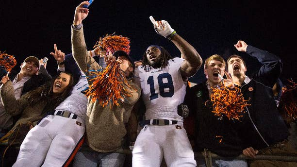 Auburn wide receiver Sammie Coates (18) celebrates with Auburn fans after a victory over Mississippi in an NCAA college football game, Saturday, Nov. 1, 2014, in Oxford, Miss. Auburn won 35-31. (AP Photo/Brynn Anderson)