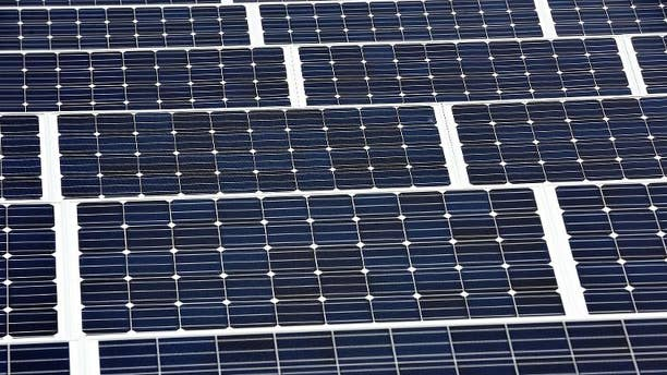 Solar panels are installed on the roof of a building in Lille on September 9, 2013