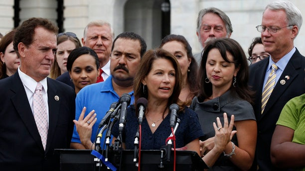 July 21: Tea Party caucus leader Rep. Michele Bachmann, R-Minn., center, speaks at a news conference on Capitol Hill in Washington.