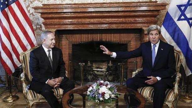 Secretary of State John Kerry, right, talks with Israeli premier Benjamin Netanyahu in Rome.