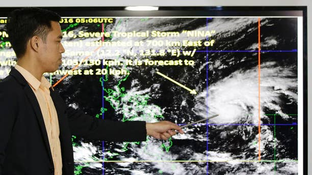 Weather specialist Benison Estareja shows the track of Tropical Storm Nock-Ten during a press conference in Quezon city, north of Manila, Philippines on Friday, Dec. 23, 2016. A severe tropical storm has gained strength as it moves closer to the Philippines and may intensify further into a typhoon, bringing moderate to heavy rains and blustery weather on Christmas Day, the biggest holiday in the predominantly Roman Catholic nation, weather forecasters said. (AP Photo/Aaron Favila)