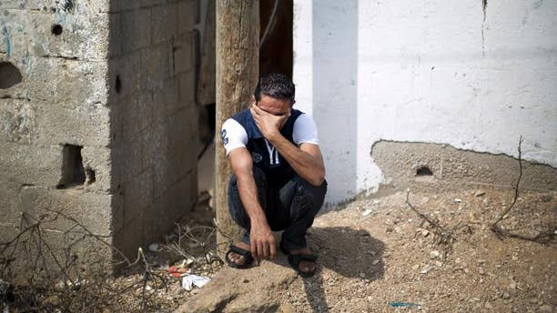 A relative of Palestinian Huweshil Abu Huweshil mourns during his funeral on October 1, 2013