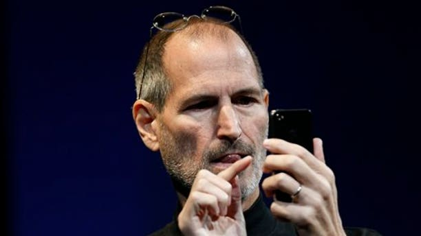 Apple CEO Steve Jobs uses the new iPhone during the Apple Worldwide Developers Conference, Monday, June 7, 2010, in San Francisco.