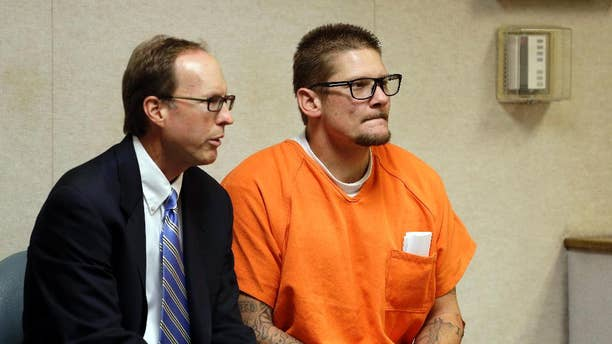 Wayne Allen Huntsman, right, appears in the El Dorado Superior Court with Public Defender William Dittman for charges related to the King Fire, in Placerville, Calif., Friday, Sept. 19, 2014. Huntsman pleaded not guilty to an arson charge. He was being held on $10 million bail after authorities said he started the blaze. (AP Photo/Rich Pedroncelli)