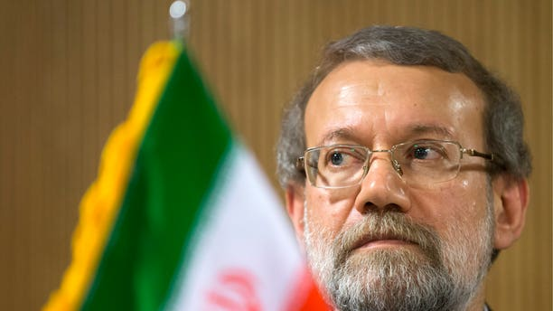 Iran's Parliament speaker Ali Larijani listens to a question during a press conference on the sidelines of the 129th Assembly of the Inter-Parliamentary Union (IPU), in Geneva, Switzerland, Wednesday, Oct. 9, 2013. (AP Photo/Keystone, Salvatore Di Nolfi)