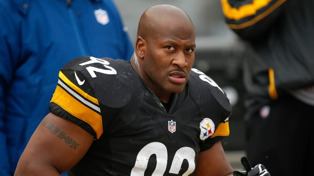 FILE - In this Dec. 30, 2012 file photo, Pittsburgh Steelers outside linebacker James Harrison (92) sits on the sidelines during the fourth quarter of an NFL football game against the Cleveland Browns in Pittsburgh. The Cincinnati Bengals have officially signed free agent James Harrison, the five-time Pro Bowl linebacker from the rival Steelers. The Bengals didn't release terms in Tuesday's, April 23, 2013 announcement. (AP Photo/Gene J. Puskar, File)