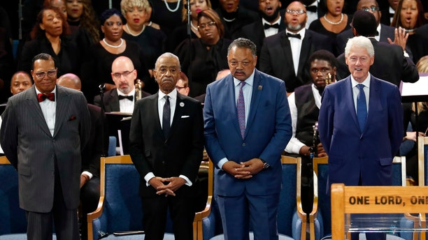Louis Farrakhan, from left, Rev. Al Sharpton, Rev. Jesse Jackson and former President Bill Clinton attend the funeral service for Aretha Franklin at Greater Grace Temple, Friday, Aug. 31, 2018, in Detroit. Franklin died Aug. 16, 2018 of pancreatic cancer at the age of 76. (AP Photo/Paul Sancya)