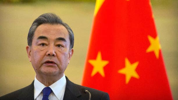 Chinese Foreign Minister Wang Yi speaks during a joint press conference with Palestinian Foreign Minister Riyad Al-Maliki at the Ministry of Foreign Affairs in Beijing, Thursday, April 13, 2017. (AP Photo/Mark Schiefelbein)