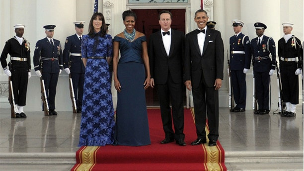 March 14, 2012: President Barack Obama and first lady Michelle Obama with Britain's Prime Minister David Cameron and his wife Samantha Cameron as they arrive in the North Portico of the White House prior to a State Dinner