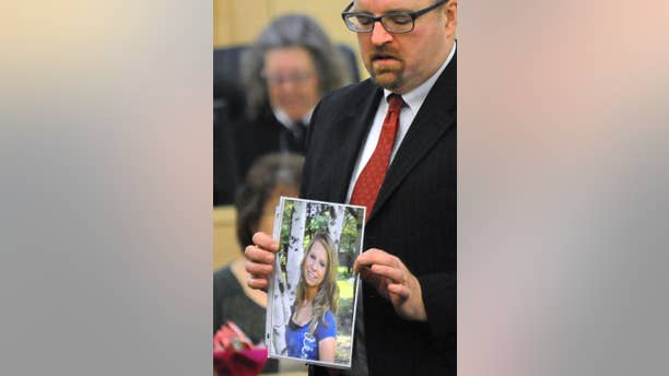 FILE - In this Feb. 23, 2015 file photo, Assistant Attorney Gen. Donald Macomber hold up a picture of Nichole Cable during opening arguments on the first day of Kyle Dube's trial in Bangor, Maine, where he was charged in Cable's 2013 kidnapping and murder. After less than an hour of deliberation, a jury convicted Dube Friday, March 6, 2015, of using a bogus Facebook profile to lure Cable to her death in a botched plot to look like a hero. (AP Photo/The Bangor Daily News, Gabor Degre, Pool, File)