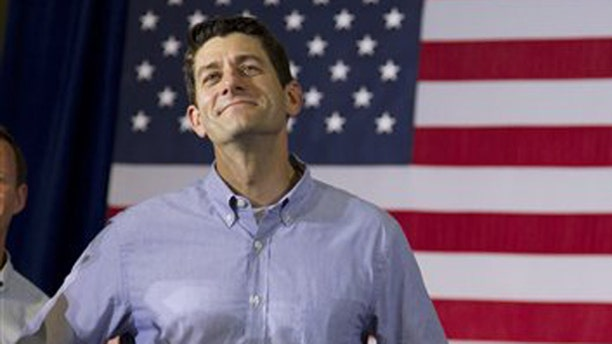 FILE: June 18, 2012: GOP Rep. Paul Ryan, R-Wis., at a campaign event with GOP presidential candidate Mitt Romney in Janesville, Wis.