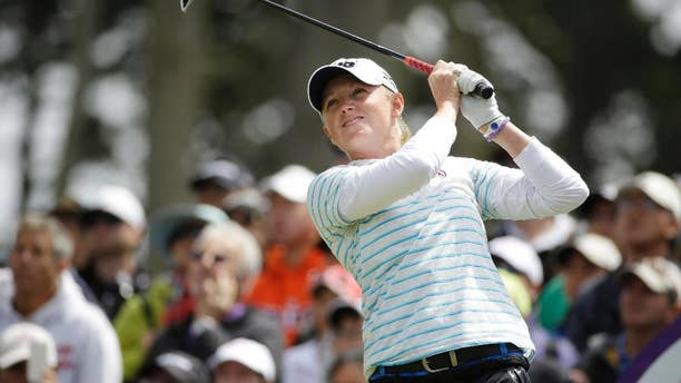 Stacy Lewis follows her shot from the third tee of Lake Merced Golf Club during the final round of the Swinging Skirts LPGA Classic golf tournament on Sunday, April 27, 2014, in Daly City, Calif. (AP Photo/Eric Risberg)