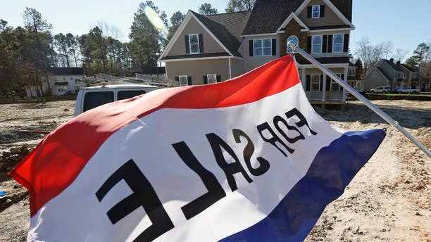 In this Jan. 8, 2015 photo, a flag advertising a new home for sale flaps in the breeze in Richmond, Va. The Commerce Department reports on U.S. sales of new homes in January on Wednesday, Feb. 25, 2015. (AP Photo/Steve Helber)