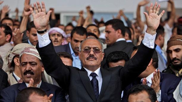 April 15: Yemeni President Ali Abdullah Saleh waves to his supporters during a rally in Sanaa, Yemen.