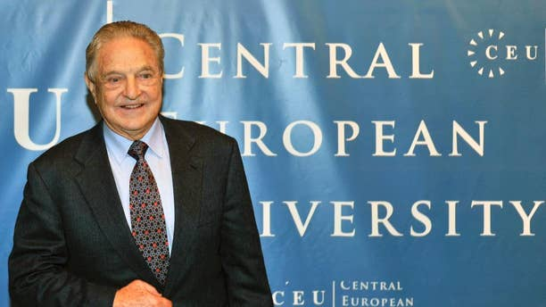 FILE - In this Oct. 26, 2009 file photo Hungarian born US billionaire and investor George Soros is pictured ahead of the start of his five-day-long lecture at the Central European University, CEU, in Budapest, Hungary. Hungary's education secretary says the government supports the work in the country of a university founded by Soros, considered an ideological opponent by Prime Minister Viktor Orban. (AP Photo/Bela Szandelszky, file)