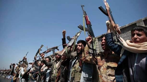 FILE - In this Oct. 2, 2016 file photo, tribesmen loyal to Houthi rebels, hold their weapons as they chant slogans during a gathering aimed at mobilizing more fighters into battlefronts in several Yemeni cities, in Sanaa, Yemen. The U.S. is weighing what military response it should take against Yemen-based Houthi rebels, who U.S. officials say launched two missiles at American warships in the Red Sea on Sunday, the Pentagon said Tuesday, Oct. 11, 2016.  (AP Photo/Hani Mohammed, File)