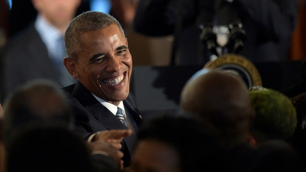 Sept. 23, 2016: President Barack Obama greets people in the crowd after speaking in the Grand Foyer of the White House in Washington at a reception for the Smithsonian Museum of African American History and Culture.