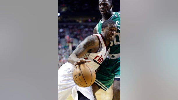 Portland Trail Blazers guard Wesley Matthews, left, drives the baseline against Boston Celtics forward Brandon Bass during the second half of an NBA basketball game in Portland, Ore., Sunday, Feb. 24, 2013.  Matthews led the Trail Blazers in scoring with 24 points as they beat the Celtics 92-86.(AP Photo/Don Ryan)