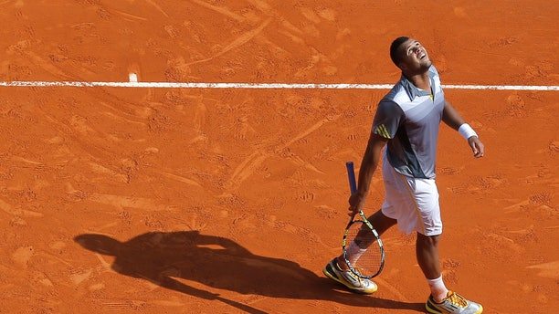 France's Jo Wilfid Tsonga reacts during his match of the Monte Carlo Tennis Masters tournament in Monaco  against Russia's Nikolay Davydenko, Tuesday, April 16, 2013. (AP Photo/Lionel Cironneau)