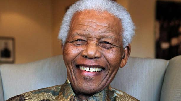 A photo taken on August 25, 2010 shows former South Africa's President Nelson Mandela in this handout photograph released by the Nelson Mandela Foundation