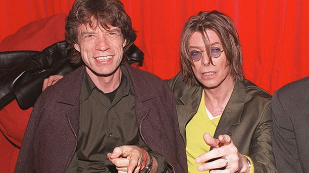December 2, 1999. Singers David Bowie (R) and Mick Jagger (L) at POP in Soho, London.