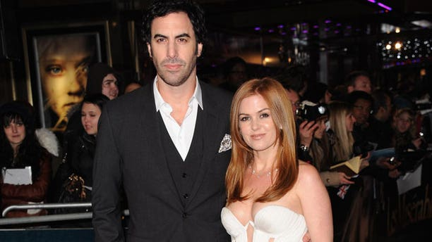 Ted Koppel says Sacha Baron Cohen, shown with wife Isla Fisher, duped him into an interview.