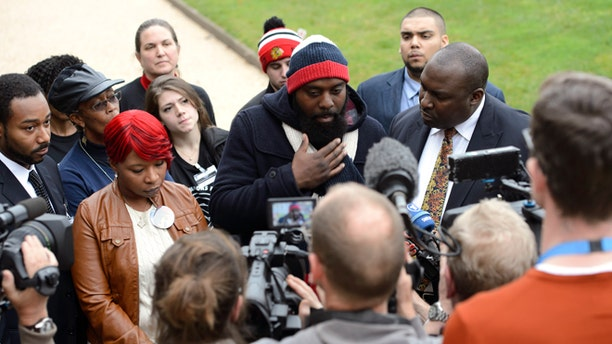Nov. 12, 2014: Lesley McSpadden, left, and Michael Brown, Sr., right, parents of teenager Michael Brown who was shot by a policeman in Ferguson, Missouri, speak during a press conference about the UN Committee Against Torture who convenes this week to evaluate the US government's compliance with the Convention Against Torture, in Geneva, Switzerland.