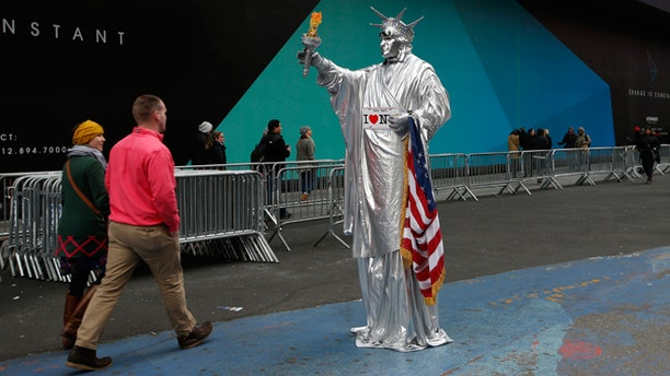 Dec. 30, 2014: A costumed character dressed as the Statue of Liberty stands in a quiet area of Times Square in New York.