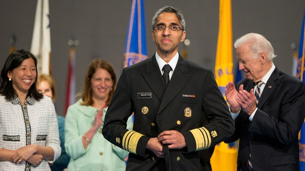 April 22, 2015: Alice Chen, left, Health and Human Services Secretary Sylvia Burwell, second from left, and Vice President Joe Biden, right, stand with U.S. Surgeon General Vivek Murthy, center, after he is ceremonially sworn-in in Conmy Hall at Fort Myer in Arlington, Va. Chen is the fiancé of Murthy.