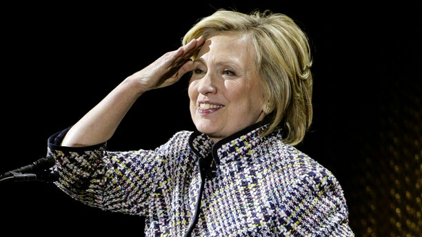 April 23, 2015: Hillary Rodham Clinton reacts to applause from the crowd before speaking during the sixth annual Women in the World Summit.