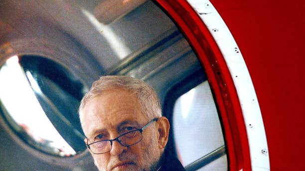 Britain's Labour party leader Jeremy Corbyn sits aboard a London bus as he waits to address the crowd at a May Day rally in central London, Sunday May 1, 2016. Corbyn has condemned anti-Semitism, and has set up an independent review of anti-Semitism and other alleged racism within the party, following issues prompted by party members over the last few days. (Anthony Devlin / PA via AP) UNITED KINGDOM OUT - NO SALES - NO ARCHIVES