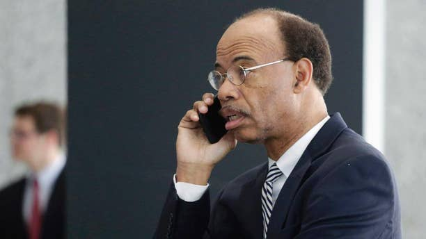 FILE - In this July 30, 2015 file photo, former Illinois Congressman Mel Reynolds talks on his cell phone as he leaves federal court in Chicago after pleading not guilty to federal tax charges. Reynolds was taken into federal custody Monday morning April 11, 2016, in Atlanta after a judge in Chicago ordered his arrest because he didn't appear for a hearing in a tax case last month, federal officials said. (AP Photo/M. Spencer Green, File)