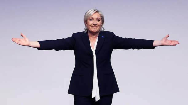 FILE - In this file photo dated Saturday, Jan. 21, 2017, Far-right leader and candidate for next spring presidential elections Marine le Pen from France celebrates after her speech at a meeting of European Nationalists in Koblenz, Germany. Le Pen is scheduled to give a speech to supporters at the congress center in Lyon, France, on Sunday Feb. 5, 2017, the second day of a conference by her anti-immigration National Front party. (AP Photo/Michael Probst, FILE)