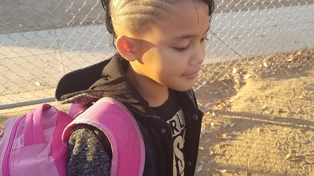 "Though the eight-year-old girl from California has rocked buzzed hairstyles since preschool, a teacher recently singled her out for her ""distracting haircut."""