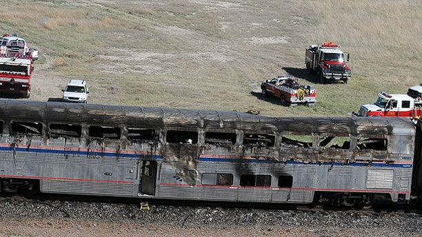 June 24: An Amtrak coach car is seen at the site of a collision between an Amtrak westbound train and a truck on U.S. 95 about 4 miles south of Interstate 80, 70 miles east of Reno, Nev.