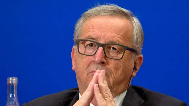 European Commission President Jean-Claude Juncker listens to a speech during the 11th EU-China Business Summit at the Great Hall of the People in Beijing, Wednesday, July 13, 2016. (AP Photo/Ng Han Guan, Pool)