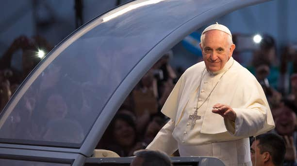 RIO DE JANEIRO, BRAZIL - JULY 26:  Pope Francis waves from the Popemobile on his way to attend the Via Crucis on Copacabana Beach during World Youth Day celebrations on July 26, 2013 in Rio de Janeiro, Brazil. More than 1.5 million pilgrims are expected to join the pontiff for his visit to the Catholic Church's World Youth Day celebrations which is running July 23-28. (Photo by Buda Mendes/Getty Images)