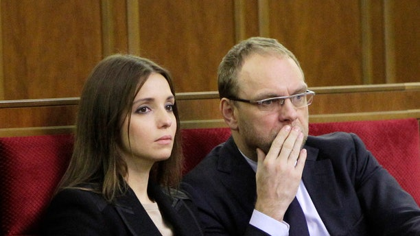 ADDS THAT THE OPPOSITION LATER SAID THAT HE WAS BEING QUESTIONED AND IS NOT ARRESTED  FILE - In this Nov. 8, 2013 file photo, Eugenia Tymoshenko, daughter of imprisoned former Ukrainian Prime Minister Yulia Tymoshenko,left, and Serhiy Vlasenko, the lawyer of former Prime Minister Yulia Tymoshenko watch a parliament session in Kiev, Ukraine. Opposition leader Arseniy Yatsenyuk told a parliamentary committee hearing on Monday Nov. 11, 2013, that he has received a text message from  Serhiy Vlasenko saying that he has been arrested, according to Yatsenyuk's spokeswoman Olha Lappo. Tymoshenko's office could not immediately confirm the arrest. Yatsenyuk said later that the opposition was reassured by a top prosecutor that Vlasenko is not arrested but is being questioned.(AP Photo/Sergei Chuzavkov, File)