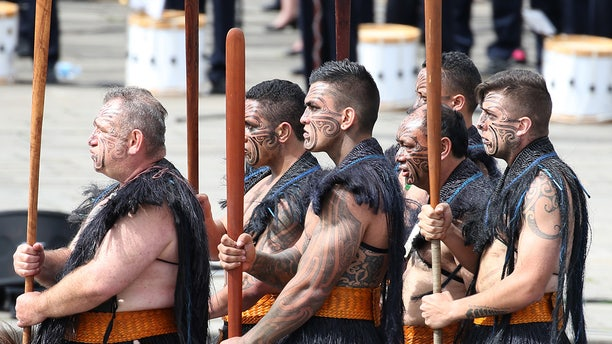 Maori warriors from New Zealand take part in the traditional Bastille Day military parade on the Champs Elysees in Paris, France.