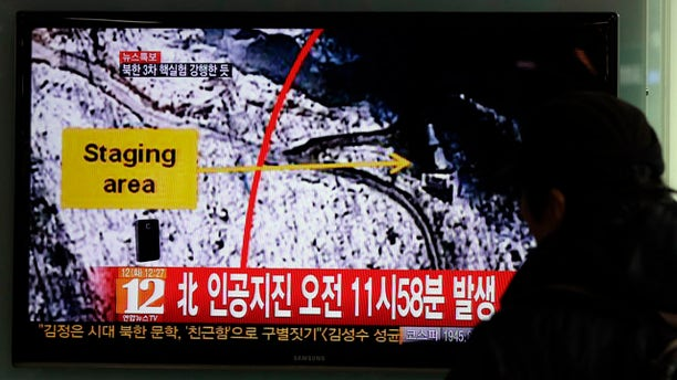 Feb. 12, 2013: South Korean passenger watches a news reporting about North Korea's nuclear test on a TV screen at the Seoul train station in Seoul, South Korea.